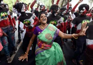 Supporters of All India Anna Dravida Munnetra Kazhagam party celebrate after winning the Tamil Nadu state assembly election outside their party office in Chennai.