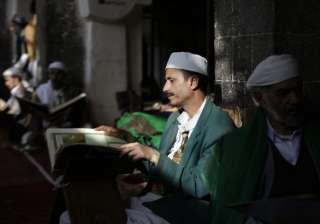 Men read verses of the Quran, Islam's holy book, on the first day of the fasting month of Ramadan in the Grand Mosque in the old city of Sanaa, Yemen.
