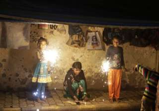 Indian street children play with firecrackers to celebrate Diwali, the Hindu festival of lights, in Allahabad.