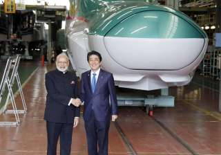 Japanese Prime Minister Shinzo Abe and Indian counterpart Narendra Modi pose in front of a bullet train in the making at a factory of Kawasaki Heavy Industries in Kobe on Saturday.