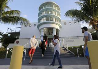 People line up to vote on Election Day in Miami.