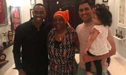 Dwayne Bravo with former Indian skipper MS Dhoni- India Tv