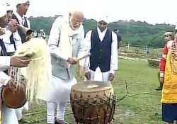 PM Modi tries his hands at drums in Meghalaya