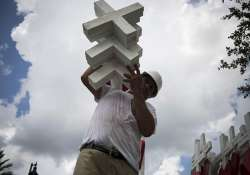 Greg Zanis carrying the crosses for the memorial