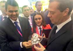 Devendra Fadnavis presents a Ganesha idol to Russian PM