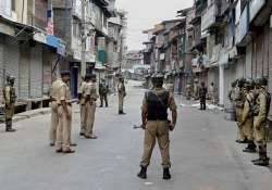 CRPF personnel guard a street during in Srinagar on Tuesday