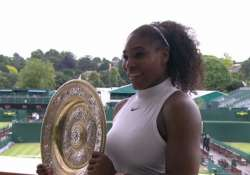 Serena Williams holding the shield