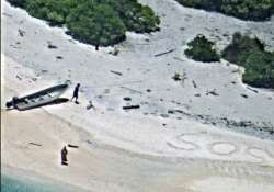 Couple rescued from remote desert island after writing SOS