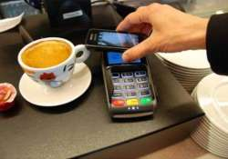 Armed with swipe machine and e-wallet, tea vendor extends