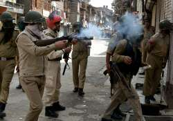 Policeman fires teargas shell to disperse protestors in