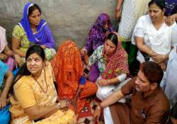 Minister Kavita Jain meeting family members of the rape