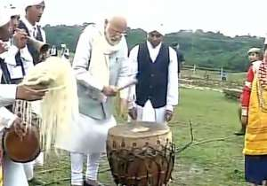 PM Modi tries his hands at drums in Meghalaya- India Tv