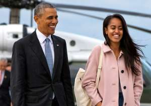 US President Barack Obama with his elder daughter Malia- India Tv