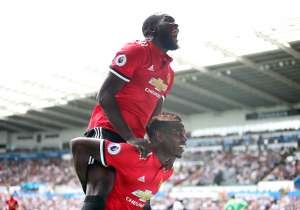 Manchester United's Paul Pogba and Romelu Lukaku celebrate.