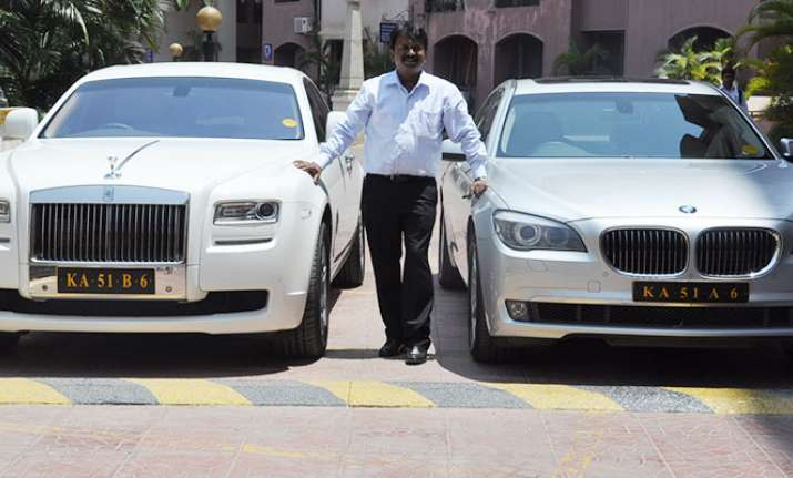 This Bengaluru barber owns 150 luxury cars, including a