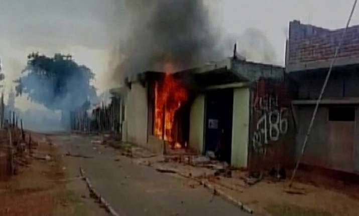 Man thrashed, house set on fire by mob on suspicion of cow