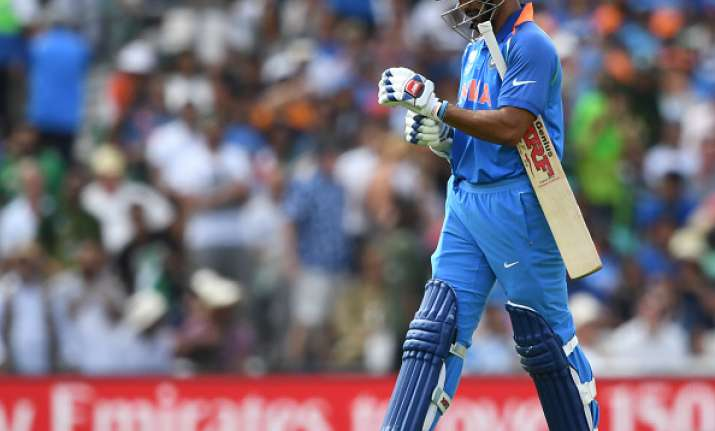 Shikhar Dhawan of India leaves the field