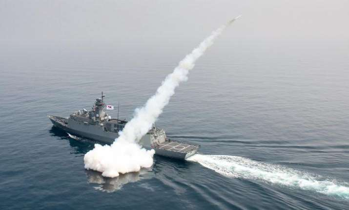 A South Korean navy ship fires a missile during a drill in