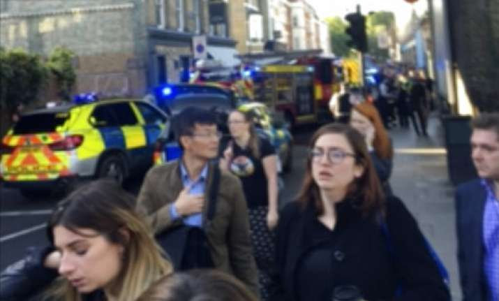 People leave the scene of an explosion
