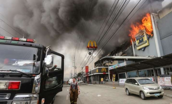 1 body recovered, 36 feared dead in Philippine mall fire