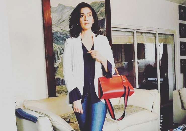 Manisha Koirala rules all over in this picture. The bag and shoes catch the eye. - India Tv