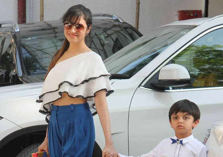 Divya Khosla Kumar colour coordinates with son Ruhaan at the party. - India Tv