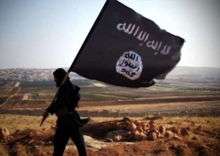 File pic - ISIS militant waves terror outfit's flag - India Tv
