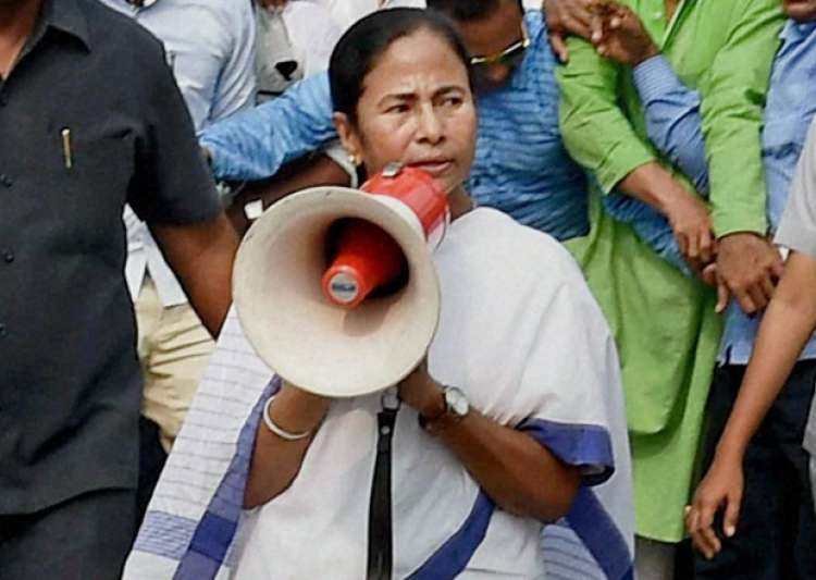 Mamata Banerjee addresses during a rally against