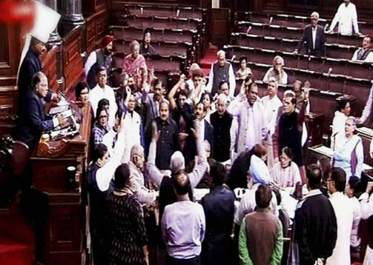 Opposition members protest in the well of the Rajya Sabha- India Tv