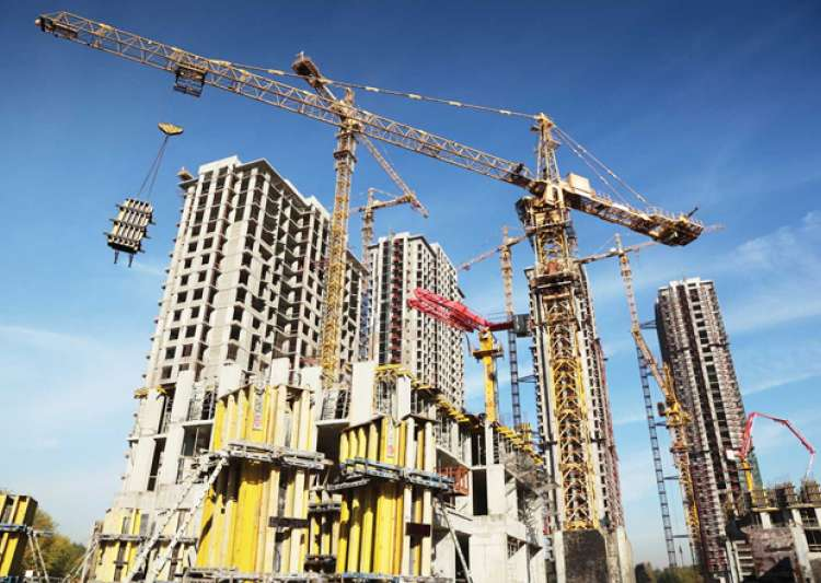 File pic of an underconstruction building in Noida - India Tv