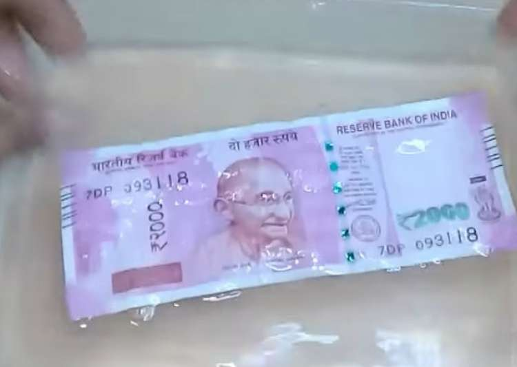 If new notes don't leak colour on rubbing, they are fake- India Tv