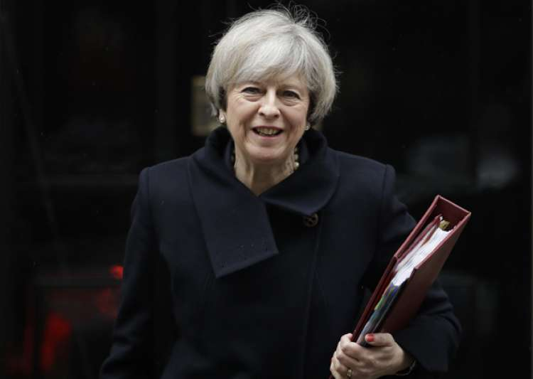 May leaves 10 Downing Street in London to attend PM's
