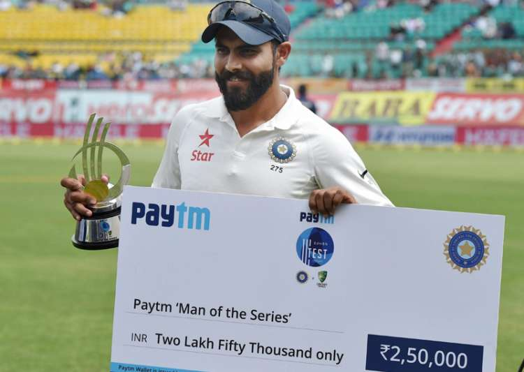 Jadeja poses in front of camera with 'man of the series'
