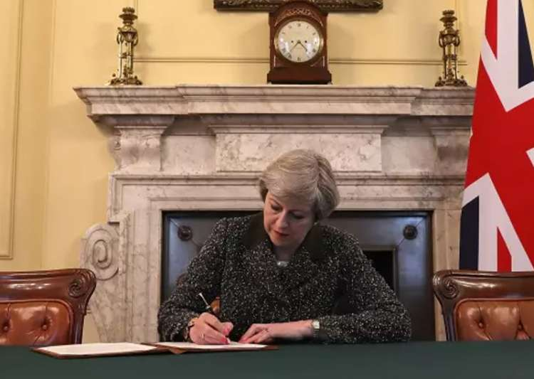 Theresa May signs the letter triggering Article 50 in