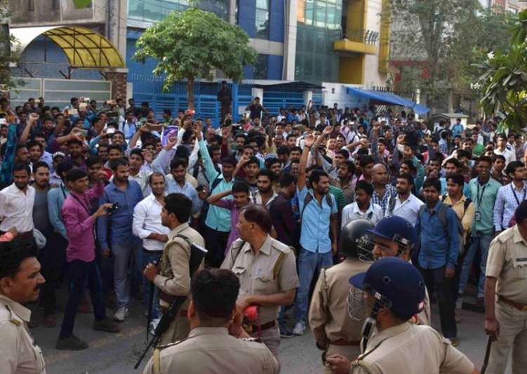 Oppo employees protest outside the assembling unit of- India Tv