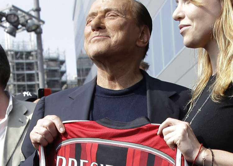 Silvio Berlusconi sells AC Milan to Chinese-backed- India Tv