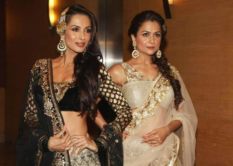 Malaika and Amrita sizzles in this magazine cover- India Tv