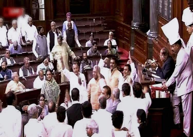 Opposition members protest in Rajya Sabha over alleged EVM- India Tv