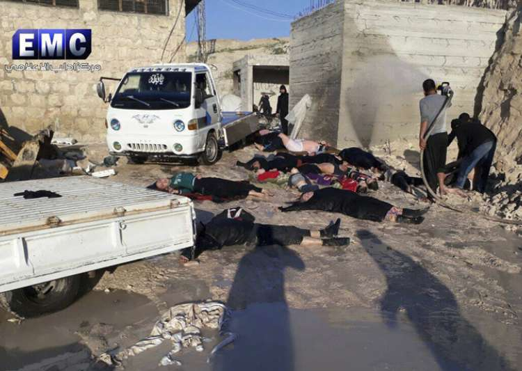 Russia defends ally Assad as death toll in Syria chemical