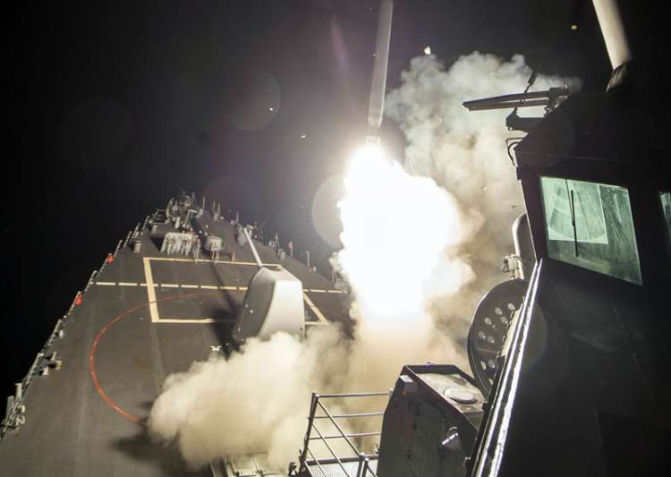 USS Ross (DDG 71) fires a tomahawk land attack missile from- India Tv