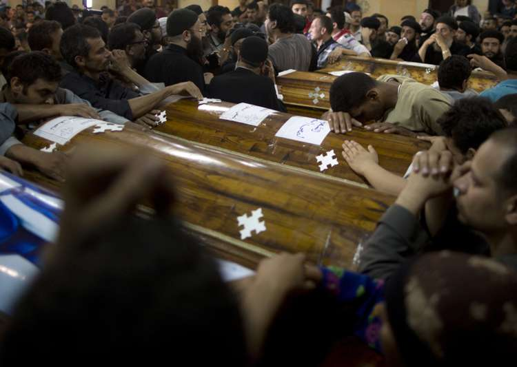 Relatives of Coptic Christians who were killed during a bus- India Tv