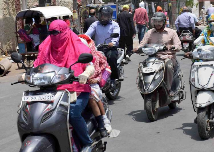 People cover their faces to protect themselves from heat in- India Tv