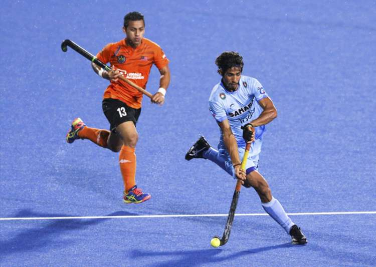 Pardeep keeps the ball off Malaysia's Firhan during Sultan