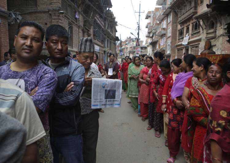 Nepalese stand in a queue to cast their votes during the- India Tv