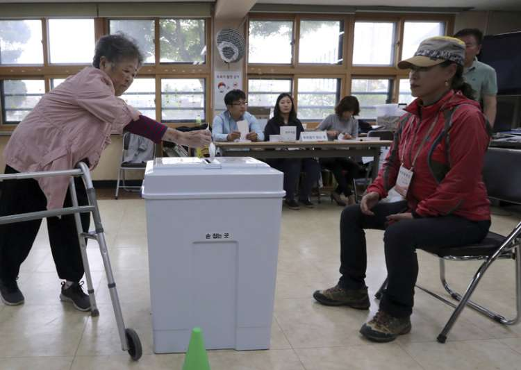 A woman casts her ballot for presidential election at a