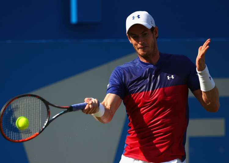 Andy Murray of Great Britain plays a forehand during the