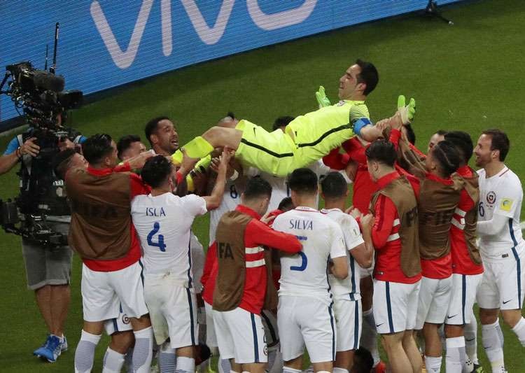 Chile players celebrate their win against Portugal in- India Tv