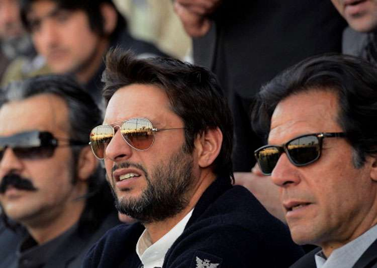 A file image of Imran Khan and Shahid Afridi.- India Tv