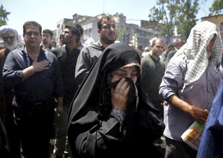 Iranians attend the funeral of victims of an Islamic State