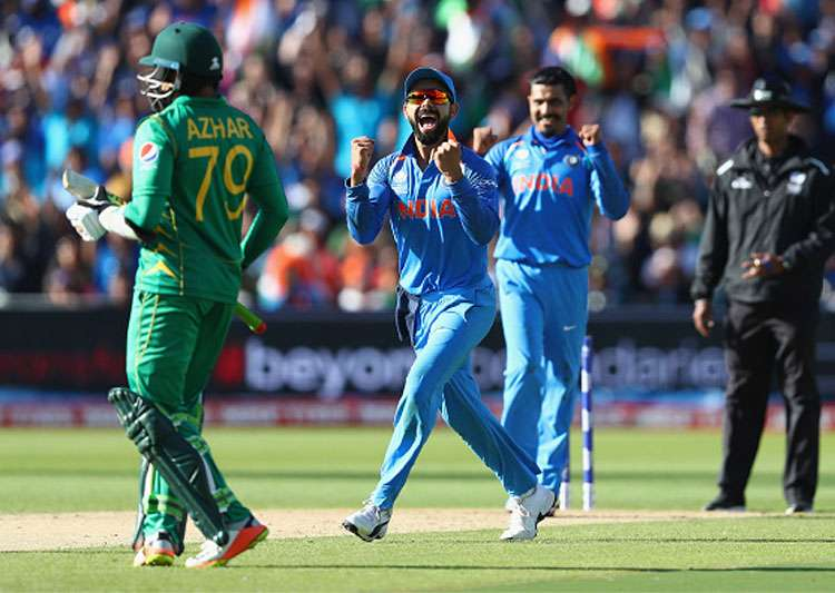 Virat Kohli celebrates the dismissal of a Pakistan batsman.- India Tv